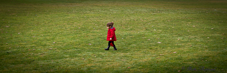 At Seward Park in a red coat