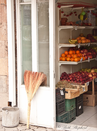 Broom and fruit stand in Gyumri