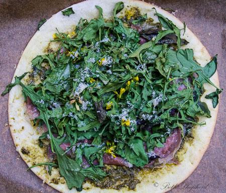Garden pizza with speck americano prosciutto
