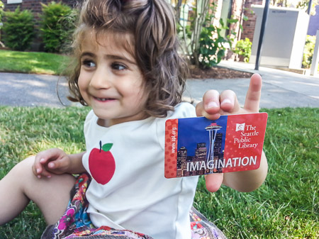 Newest Seattle Library member with her library card