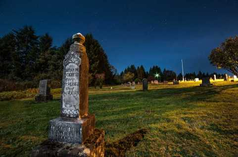 Photo Credit: SPOKESMAN FILE PHOTO: JOSH KULLA - Pleasant View is one of the biggest pioneer cemeteries in Oregon and includes the graves of 170 veterans of conflicts dating back to the 1830s. Dawson's project includes repainting the flagpole in the background of this photo and installing at its base a plaque commemorating veterans' service.