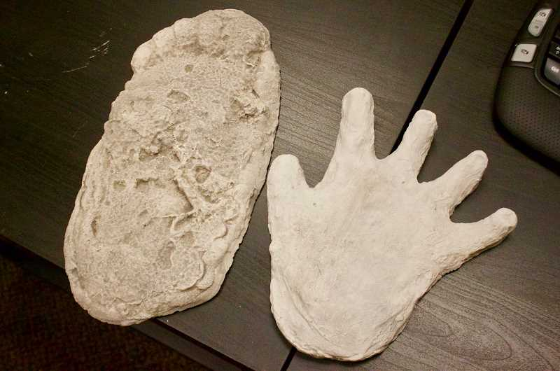 OUTLOOK PHOTO: CHRISTOPHER KEIZUR - The left footprint was found in 1967 at the site of the Patterson-Gimlin video, cast by Bob Titmus, while the handprint on the right was cast by Wes Sumerlin.