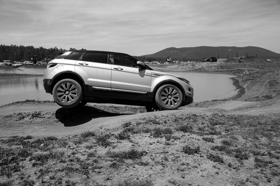 People testing out themselves and their vehicles on the driving course at Overland Expo 2014
