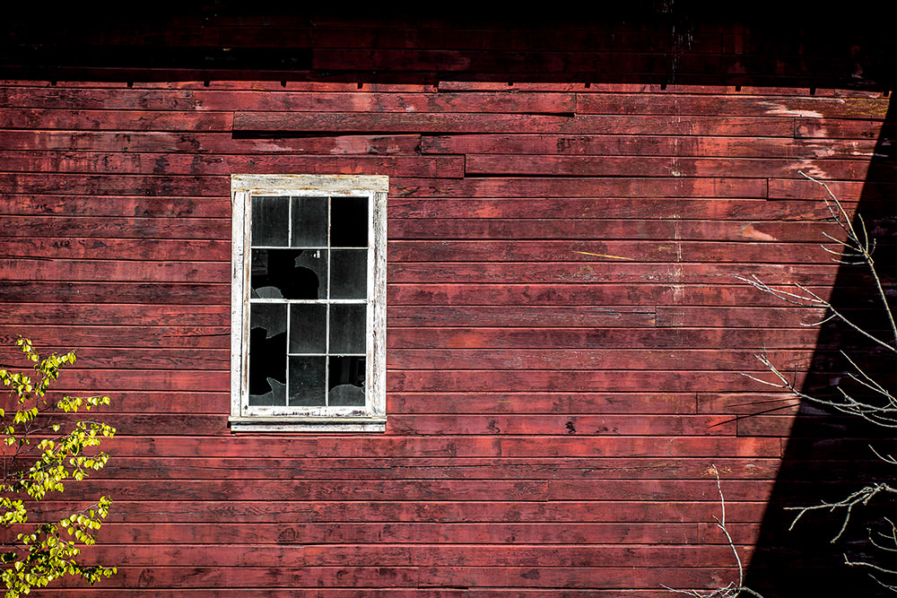 Empty window in Kennecott Copper Mill Town, Alaska