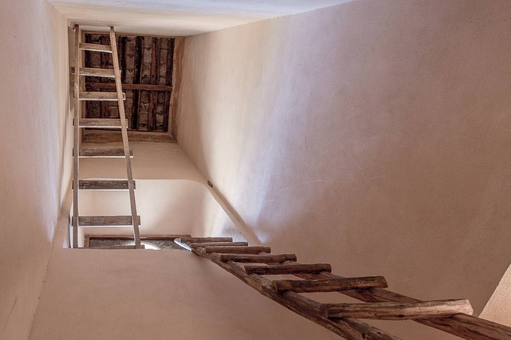 Ladders leading to the church 's bell tower.