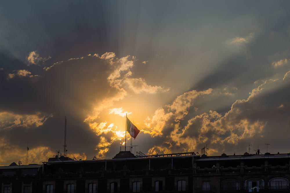The late afternoon sun fades from the Zócalo.