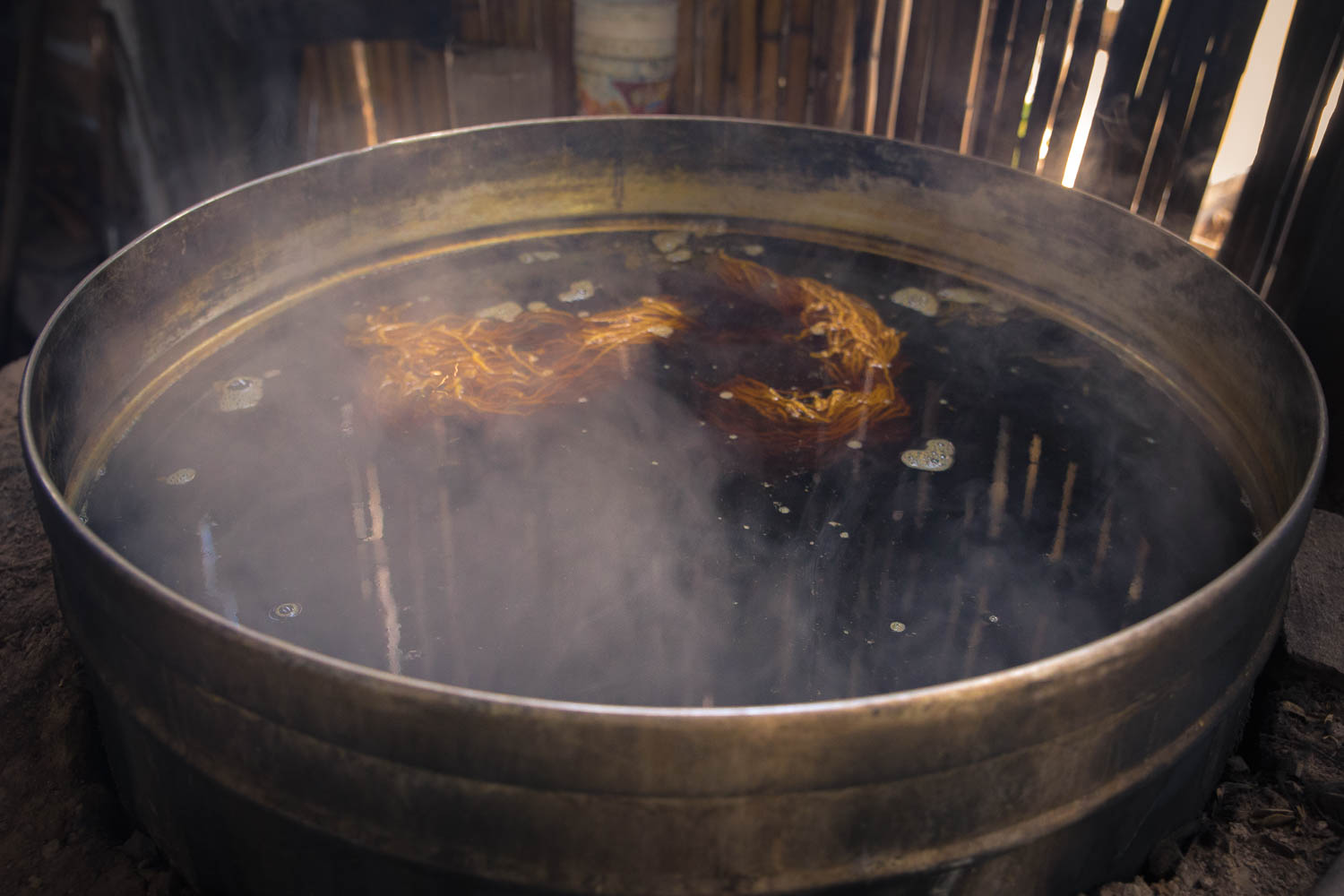 Bubbling away—A batch of wool stewing.