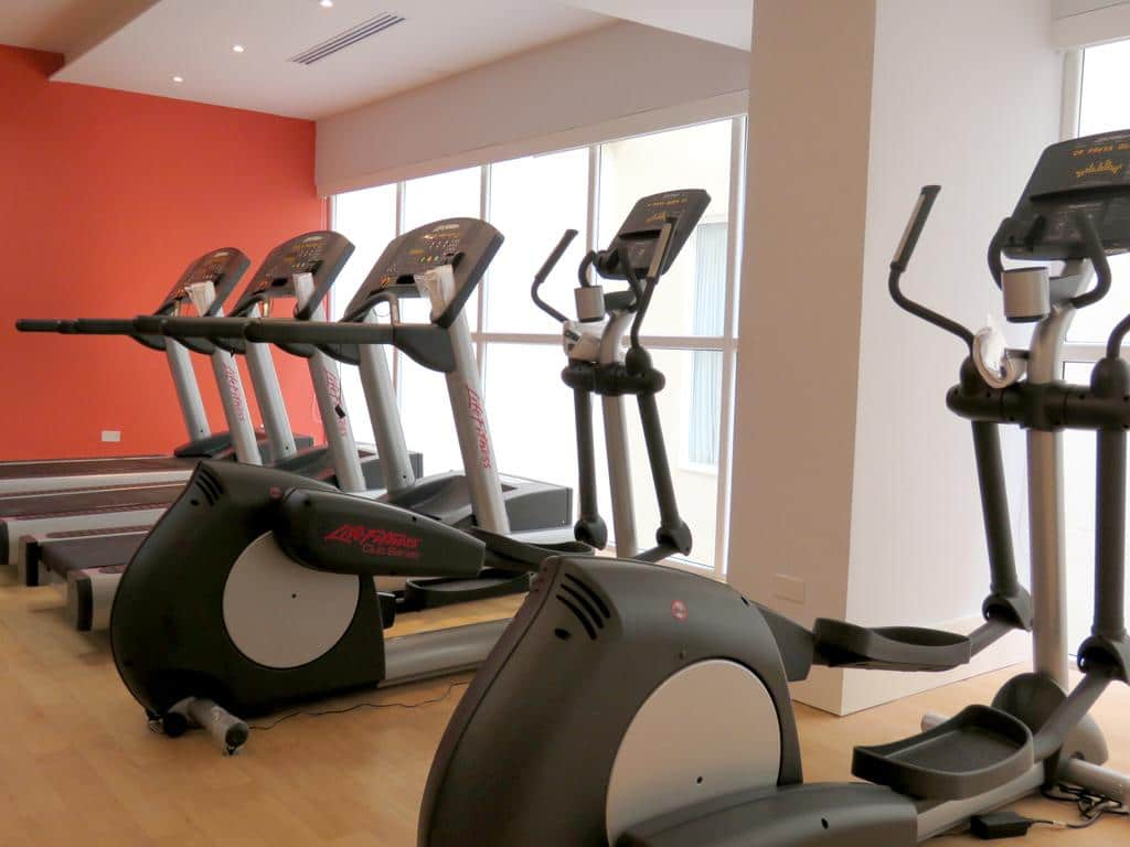 A fitness center allows people to continue their workout routines while traveling
