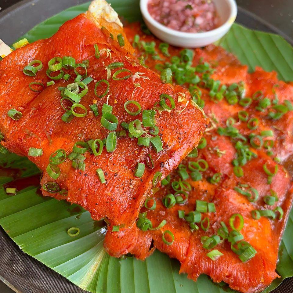 Famous toasted yuca with tuna carpaccio and onion ceviche