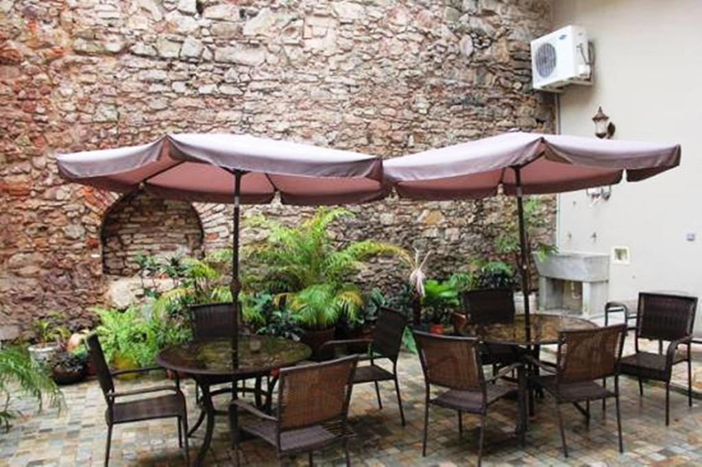 The internal courtyard is shared by all apartments in Casa Sucre Boutique Hotel