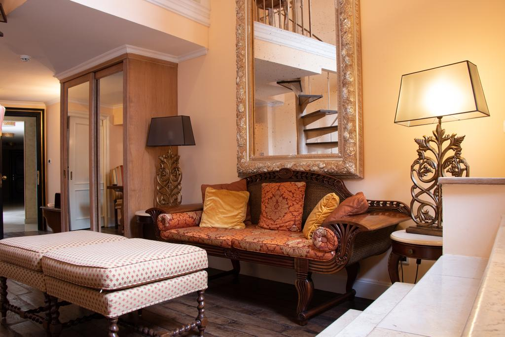 Some rooms have living rooms at Villa Palma Boutique Hotel