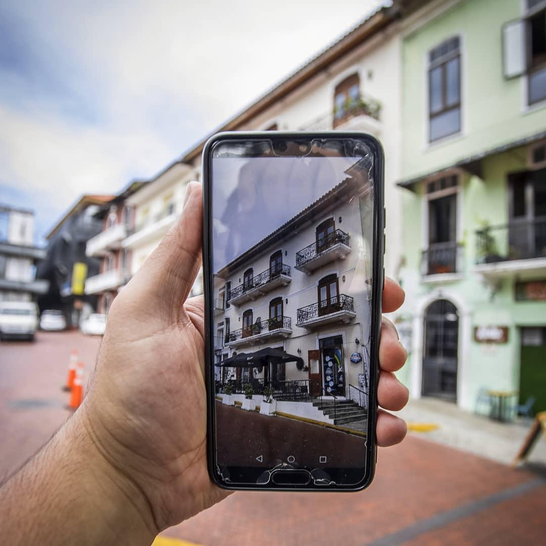 Cel phone taking a photo of Casa Antigua Hotel in casco viejo