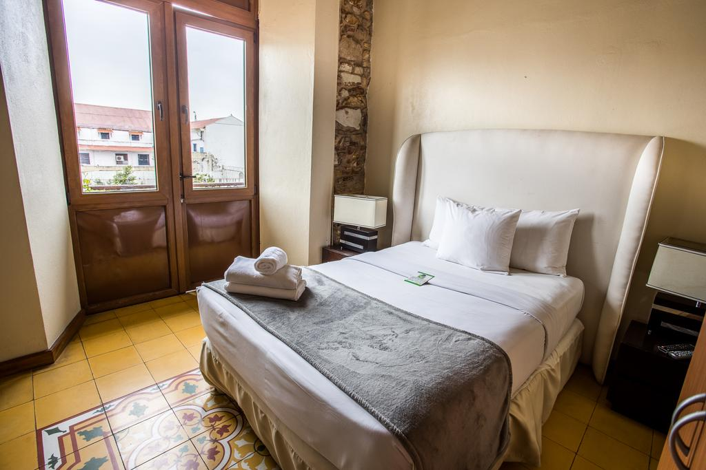 Suites at Casa Antigua Hotel have queen or king sized beds and balconies