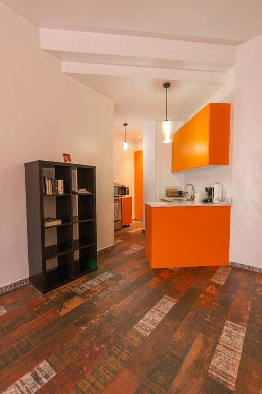 kitchen and book stand in Charming Apartment in Casco Viejo
