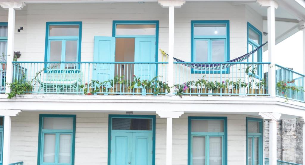 balconies of Flor de Lirio is an Antillean style building that is white with turquoise in Casco Viejo