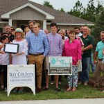 Suzanne Vickers Construction Inc. Photo in front of one of most recent completed new construction homes. More information call #850-265-8332
