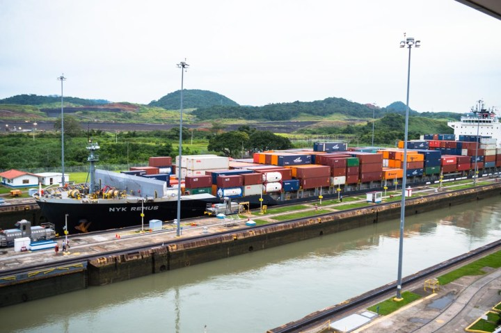 A container ship passes through the Miraflores Locks