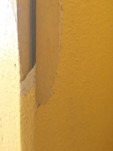 dodgy mains wire hidden by wallpaper