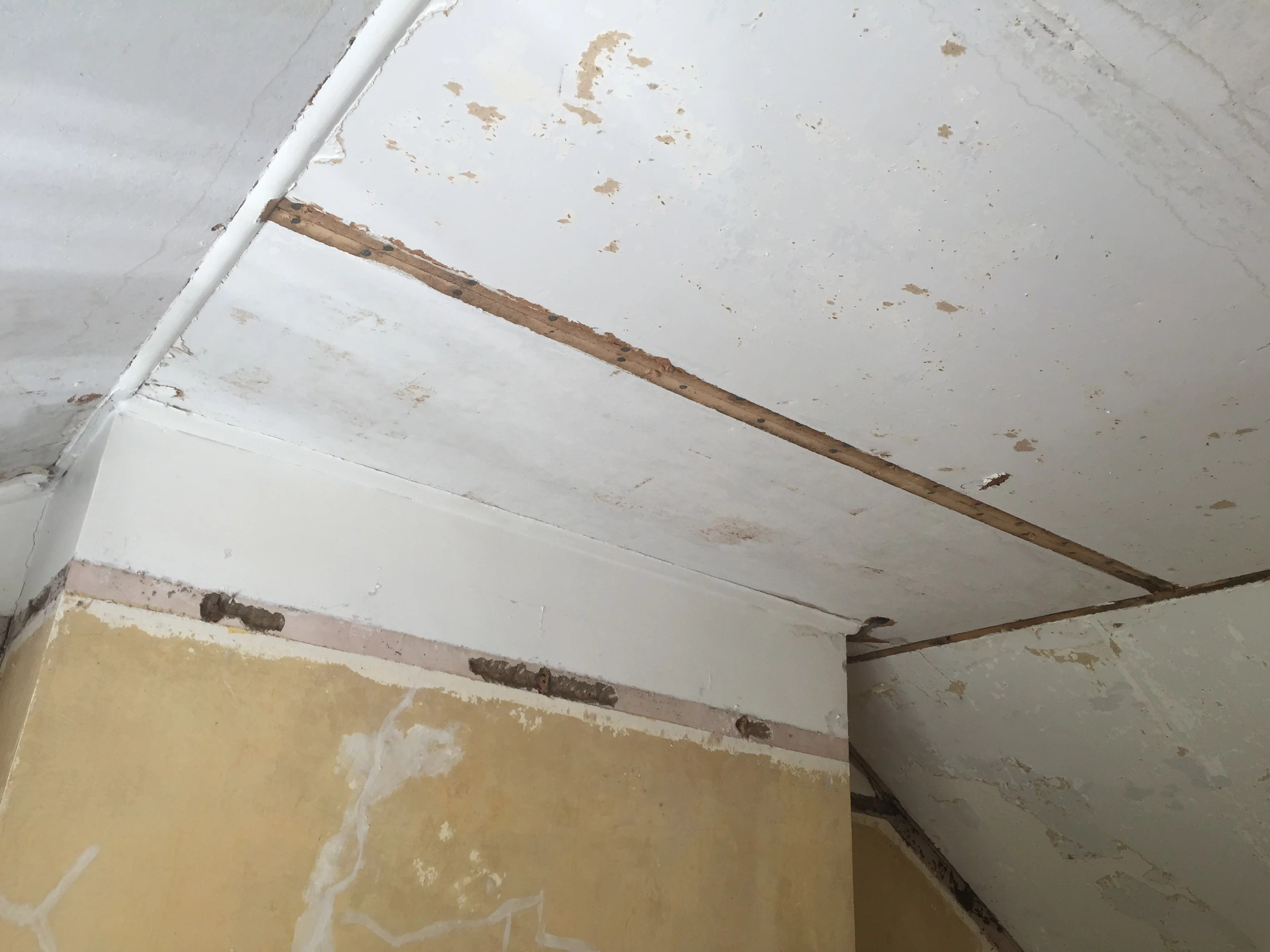 ceiling with some wood mouldings removed