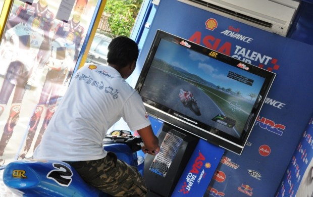 A visitor trying out the bike simulator on the Shell Advance On Wheels Truck at a previous roadshow