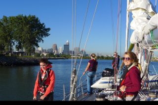 Maddie, right  and the rest of the  crew leave Cleveland in their wake as they sail across Lake Erie!