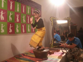 Cay Wadi, 7 years old, being filmed while dancing pangalay on top of an agung.