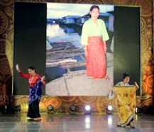 Mariel Francisco and Joy Ricote-Cruz demonstrate various ways of wearing the patajung or tubular cloth.
