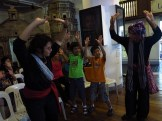 Levi Azarcon and Mannex Siapno demonstrate pangalay postures and gestures while boys enthusiastically imitate them.