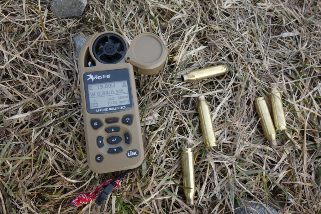 Kestrel 5700 Elite ballistic calculator with Pile of 260 Brass