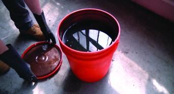 Harvested sludge before being processed in waste-oil refiner