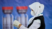 Keraguan Atas Kemanjuran Vaksin, Hambat Upaya Mendorong Laju Vaksinasi