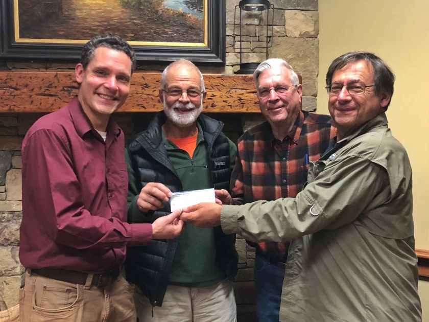 """Friends of Panthertown Executive Director, Jason  Kimenker, accepts a $7,500 donation from Panthertown Map  Association, non-profit publishers of Burt Kornegay's """"A Guide's Guide  to Panthertown"""". You can order your copy online at panthertownmap.com"""
