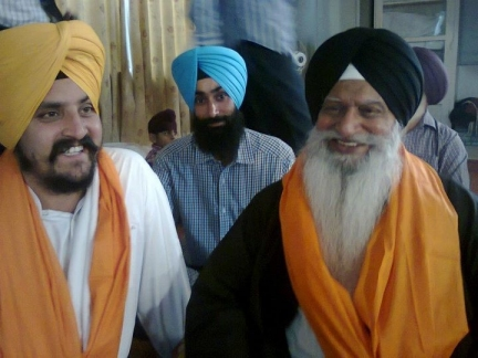 Dhunda smiling with Ex-communicated Ragi Darshan