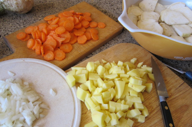 Chopped vegetables and celeriac in lemon water