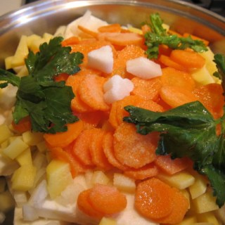 celeriac and vegetables in a pan