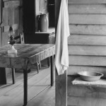 walker-evans-Part-of-the-kitchen-Home-of-sharecropper-Floyd-Burroughs-showing-washstand-in-the-dog-run-and-view-into-the-kitchen