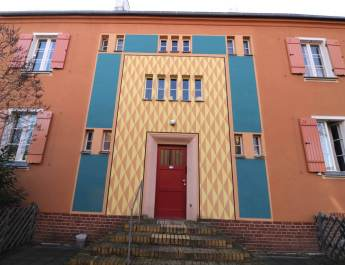 Die Gartenstadt Falkenberg zählt nicht nur wegen ihrer auffälligen Fassaden zum UNESCO-Welterbe