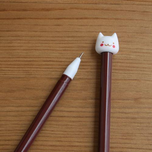 Bolígrafo marrón gato blanco