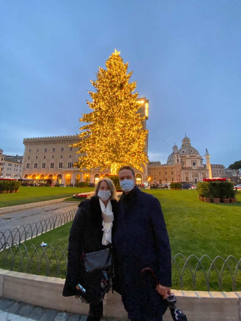 Simon and Leanne in front of the Spelacchio Christmas tree in Piazza Venezia, Rome, Italy 2020.