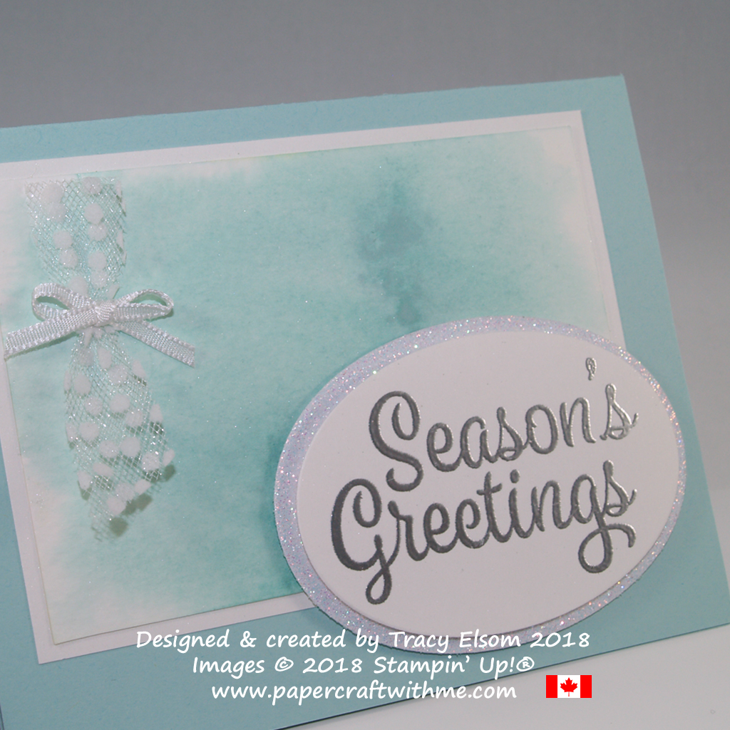Close up of seasons greetings card created using the Snowflake Sentiments Stamp Set from Stampin' Up! and a subtle sparkle background with watercoloured Shimmer Paint.