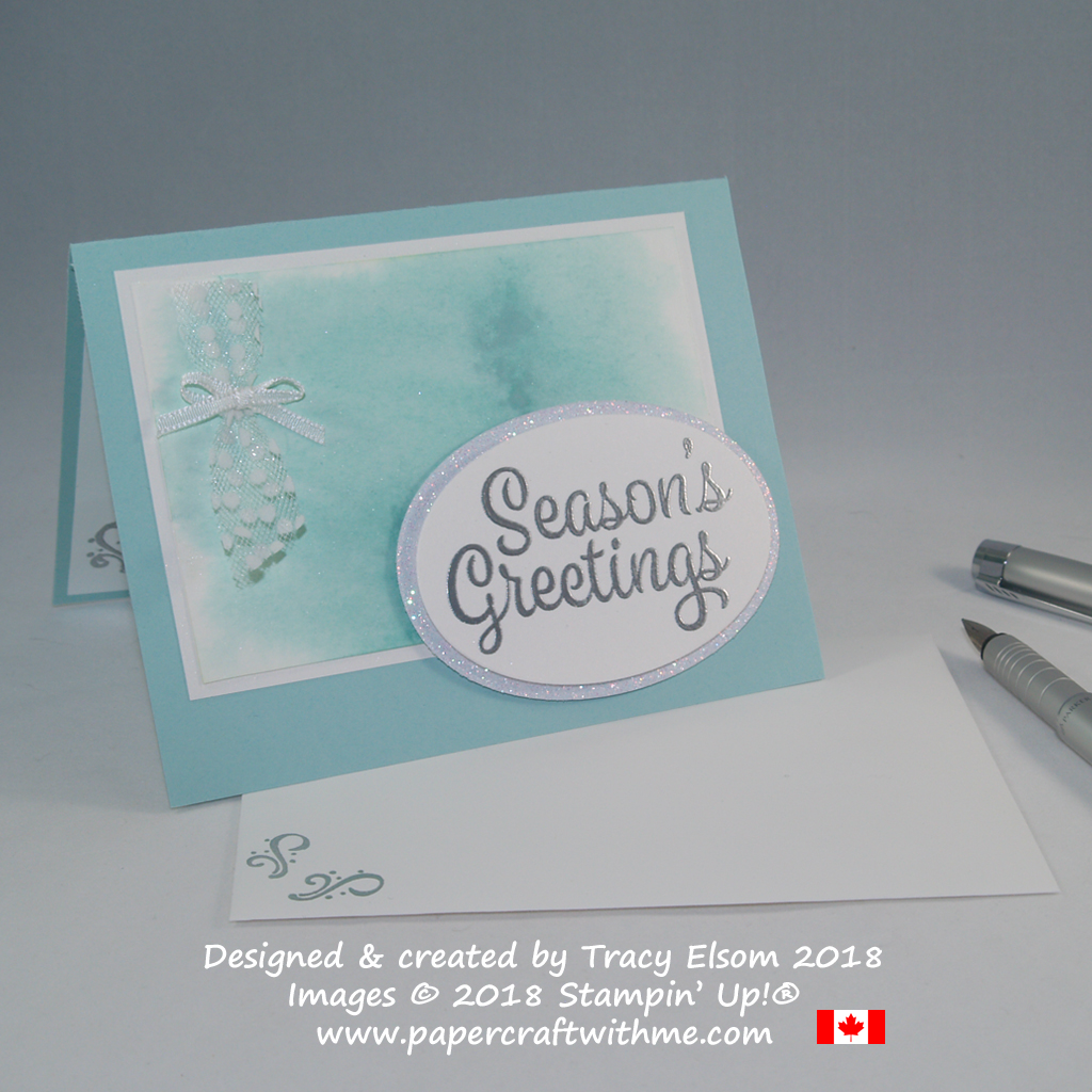 Seasons greetings card created using the Snowflake Sentiments Stamp Set from Stampin' Up! and a subtle sparkle background with watercoloured Shimmer Paint.