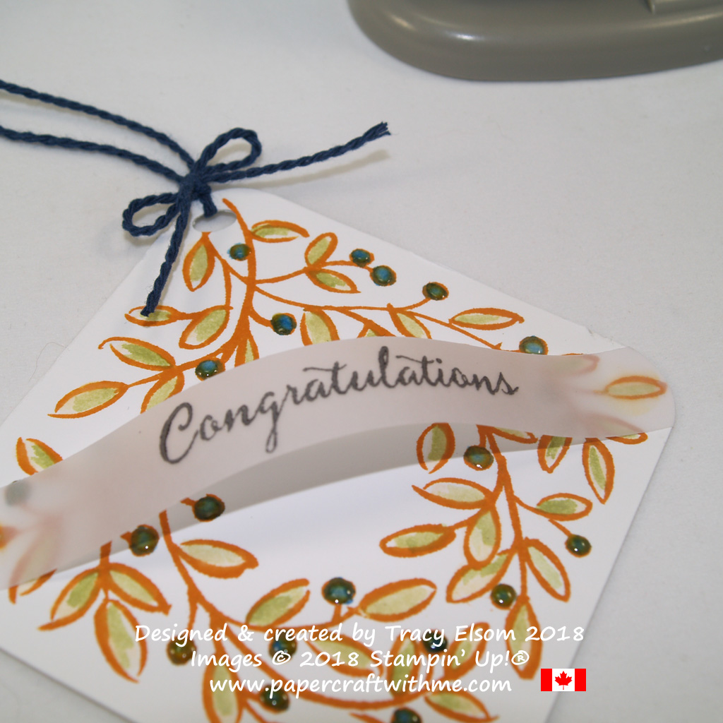Close up of square wreath tag with arched congratulations sentiment created using the Feathers & Frost and Balloon Celebration Stamp Sets from Stampin' Up!