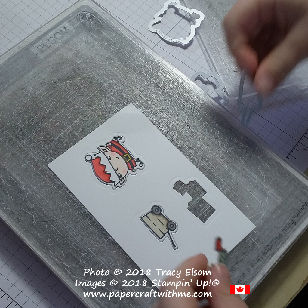 Die-cutting coloured images from the Signs of Santa Stamp Set using the coordinating Santa's Signpost Framelits Dies.