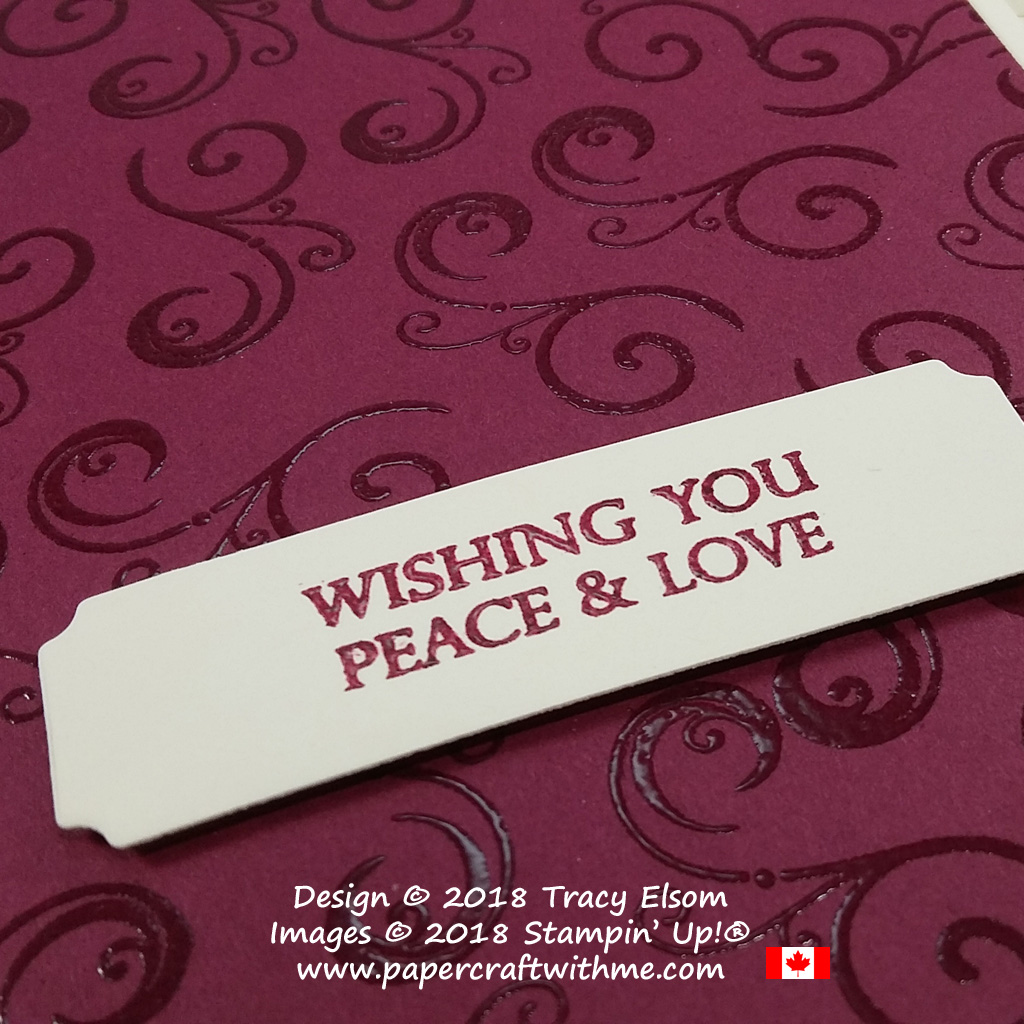 Close up of embossed card with decorative element and peace & love sentiment from the Merry Christmas To All Stamp Set from Stampin' Up!