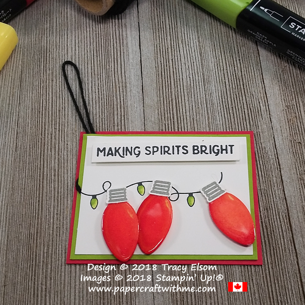 Gift tag with Christmas lights from the Making Christmas Bright Stamp Set coloured using Stampin' Blends and coated with a thick layer of clear embossing.