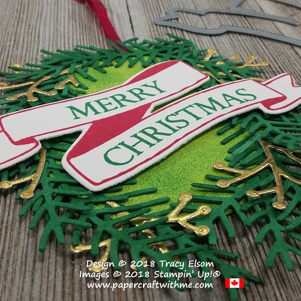 Close up of large oval wreath tag created using Merry Christmas To All and Banners For You Stamp Sets with die-cut pieces from the Pretty Pines Thinlits from Stampin' Up!