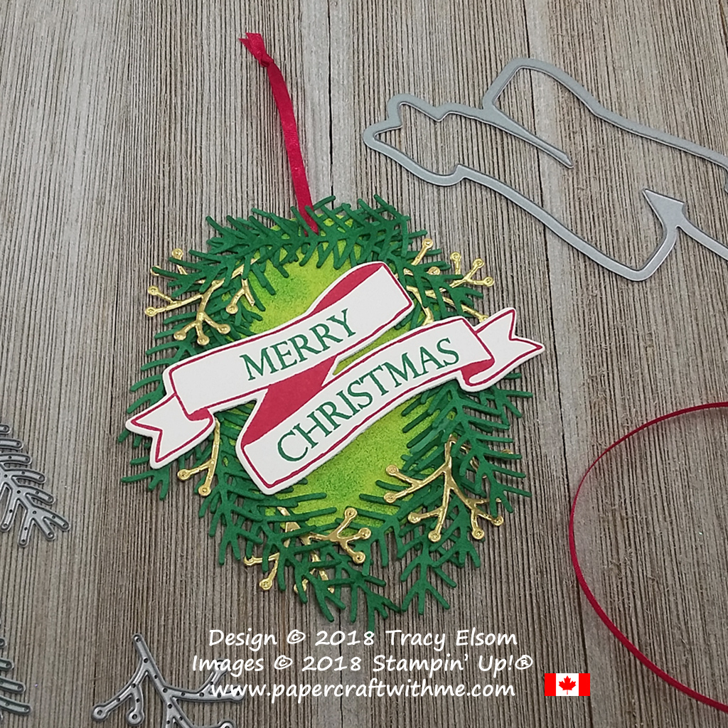 Large oval wreath tag created using Merry Christmas To All and Banners For You Stamp Sets with die-cut pieces from the Pretty Pines Thinlits from Stampin' Up!