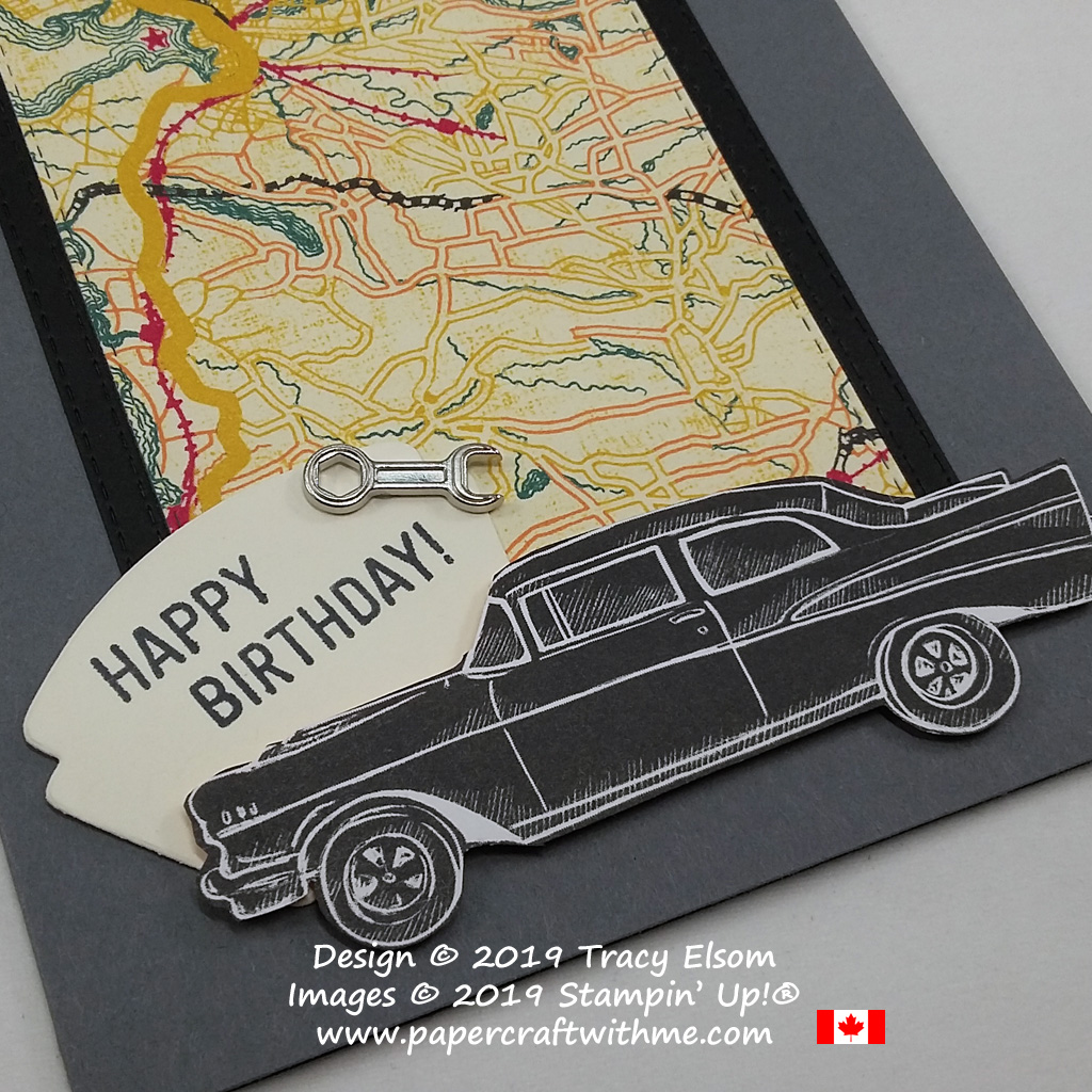 Close up of masculine birthday card with classic car and motoring theme.