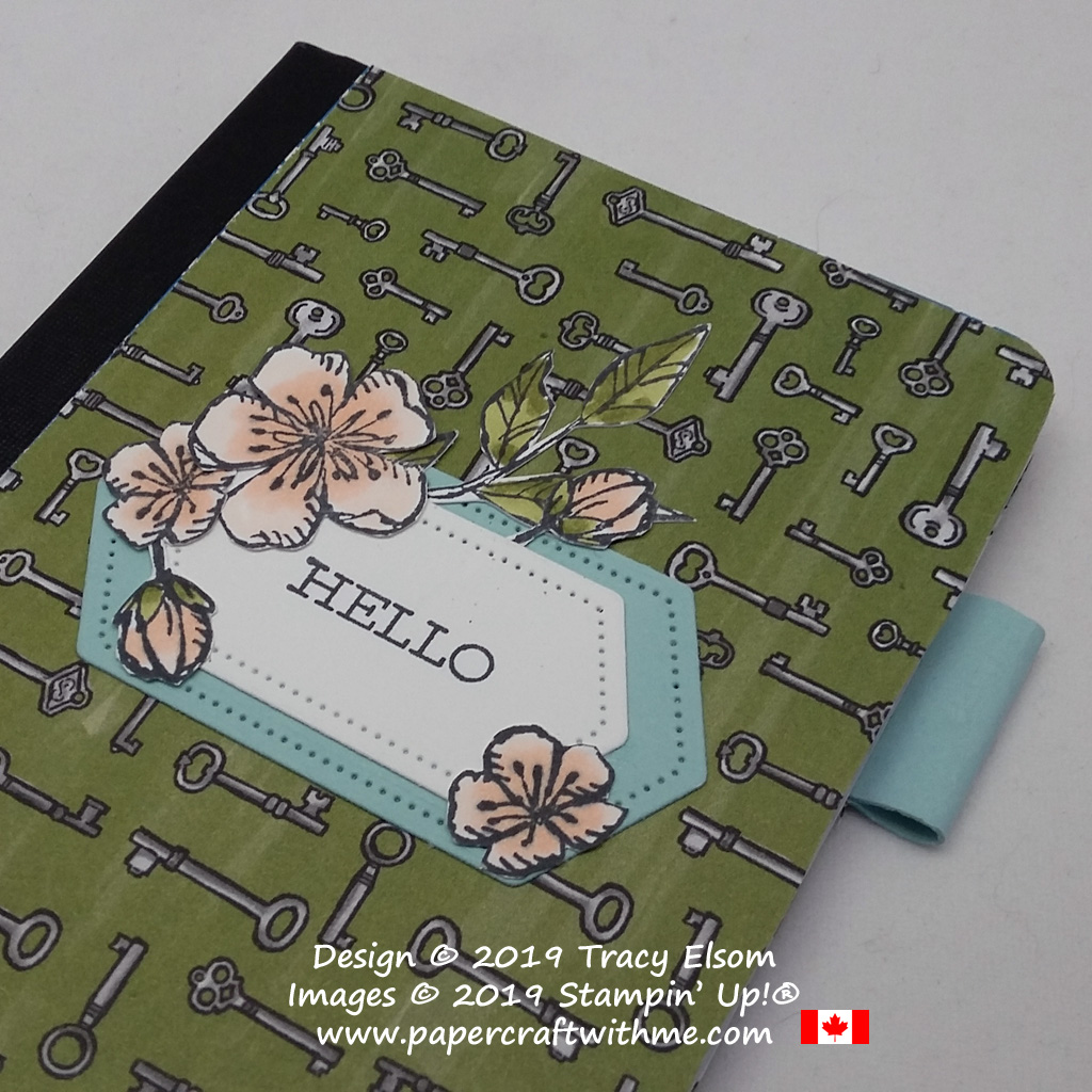 Close up of small notebook with images from the Free As A Bird Stamp Set, background paper from the Bird Ballad DSP, and layers cut using the Stitched Nested Labels Dies, all from Stampin' Up!