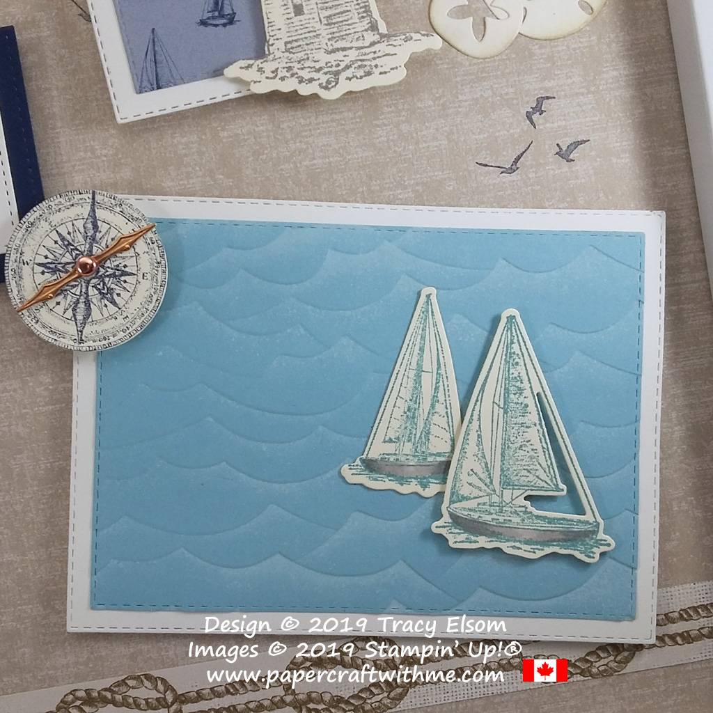 """Bottom right corner of 12"""" x 12"""" frame with seaside images created using the Sailing Home Stamp Set and coordinating Smooth Sailing Dies and High Seas 3D Embossing Folder, all from Stampin' Up!"""